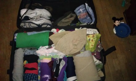 Packed Suitcase with Rolled Clothes
