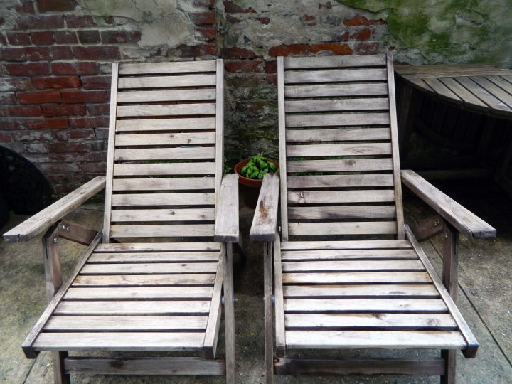 refinishing outdoor furniture after sanding