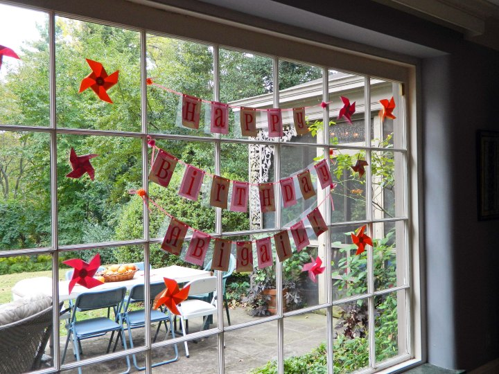 DIY-girls-first-birthday-party-pink-orange-pinwheels-banner