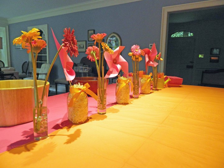 DIY-girls-first-birthday-party-pink-orange-pinwheel-centerpieces